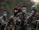 墨西哥士兵头带口罩巡逻
